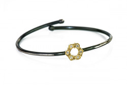 Rusty silver bracelet, yellow gold center and white diamonds.