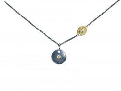 Collar de plata 925mm oxidada y satinada con oro amarillo de 750mm y 2 brillantes naturales.