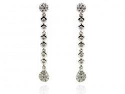 Pendientes de oro blanco con perlas y brillantes.